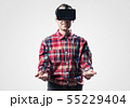 Guy in mask experiencing virtual reality as new entertainment device 55229404