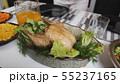 A dish of fried chicken with a delicious crust is on the table. 55237165