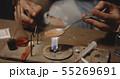 Man heating drug in a spoon 55269691