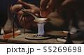 Man heating drug in a spoon 55269698