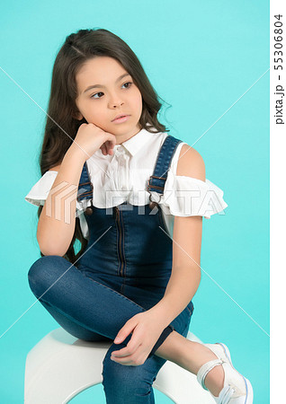 Preteen model with thinking face on blue 55306804