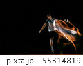 Young handball player against dark studio background in mixed light 55314819