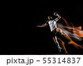 Young handball player against dark studio background in mixed light 55314837