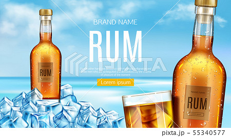 Rum bottle and glass stand of heap of ice cubes 55340577
