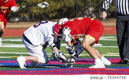 Lacrosse faceoff during high school boys game 55344739