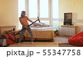Young pretty woman is hoovering the floor at home using modern vacuum cleaner and listening to music 55347758