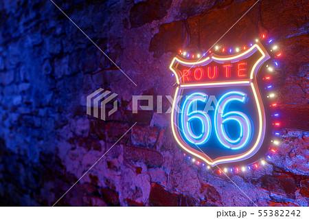 Route 66 neon light emblem banner on old grunge 55382242