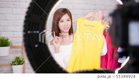 woman sell clothes in livestreaming 55389928