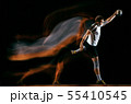 Young handball player against dark studio background in mixed light 55410545
