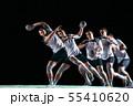 Young handball player against dark studio background in strobe light 55410620