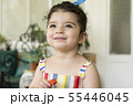 Close-up portrait of a happy little girl holding 55446045