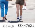 feet of pedestrians walking on the crosswalk 55447021