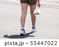 woman crossing the street at pedestrian crossing 55447022