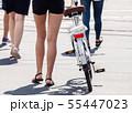 feet of pedestrians walking on the crosswalk 55447023
