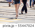 people crossing the street at pedestrian crossing 55447024