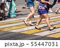 feet of pedestrians walking on the crosswalk 55447031