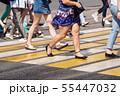 people crossing the street at pedestrian crossing 55447032
