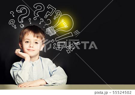 School boy with lightbulb on background. 55524502