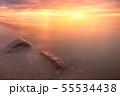 Fantasy sunset lake sunshine sunrise with stones. 55534438