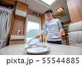 Woman cooking in camper, motorhome interior 55544885