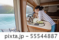 Woman in the interior of a camper RV motorhome 55544887