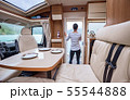 Woman in the interior of a camper RV motorhome 55544888
