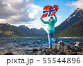 Woman with a waving flag of Norway on the 55544896
