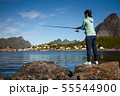 Woman fishing on Fishing rod spinning in Norway. 55544900