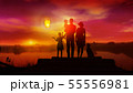 Family with children watches on launched Chinese lantern at sunset 55556981