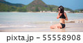 Young beautiful woman on beach during tropical vacation 55558908