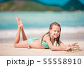 Adorable active little girl at beach during summer vacation 55558910