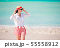 Young fashion woman in hat on the beach 55558912