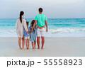 Happy beautiful family on white beach 55558923