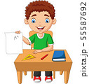 Cartoon little boy holding paper with A plus grade 55587692