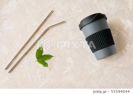 Metallic straws and reusable bamboo coffee cup.  55594044