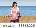 Woman drinking water after sport gym outdoor 55668225