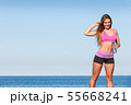 Woman drinking water after sport gym outdoor 55668241