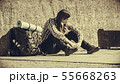 Man tourist backpacker sitting by grunge wall 55668263