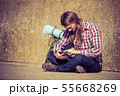 Man tourist backpacker sitting with tablet outdoor 55668269