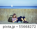 Man tourist backpacker sitting with tablet outdoor 55668272