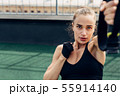 Young woman doing exercises on a rooftop 55914140