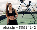 Woman looking down after intense physical training 55914142