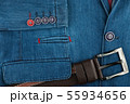 Leather belt lies on a denim jacket. Fashion 55934656