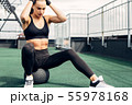 Young woman sitting on a medicine ball on a roof 55978168