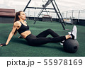 Fitness woman relaxing after training 55978169