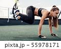 Muscular woman doing abdominal exercises  55978171