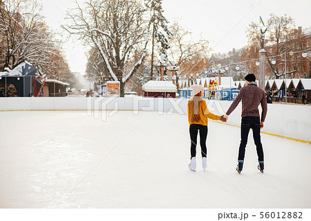 Cute couple in a ice arena 56012882
