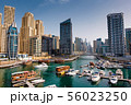 Dubai marina with boats and buildings with gates, 56023250
