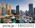 Dubai marina with boats and buildings with gates, 56023252