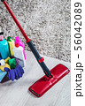 different products and items for cleaning on the floor in the room 56042089